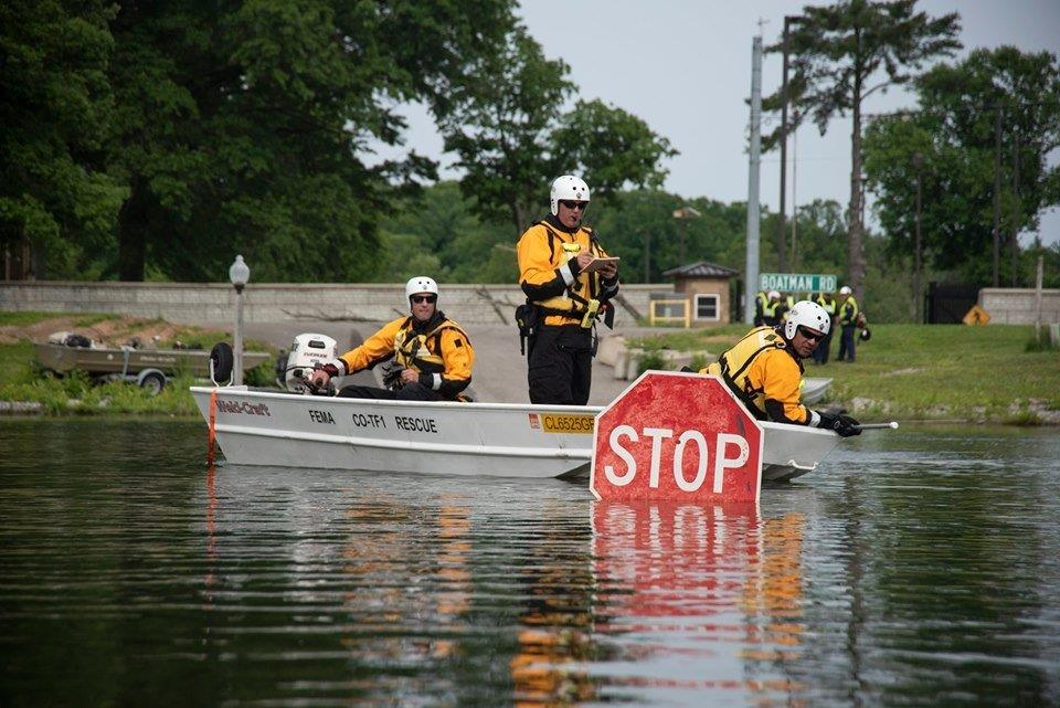 Rescue team on a flooded street